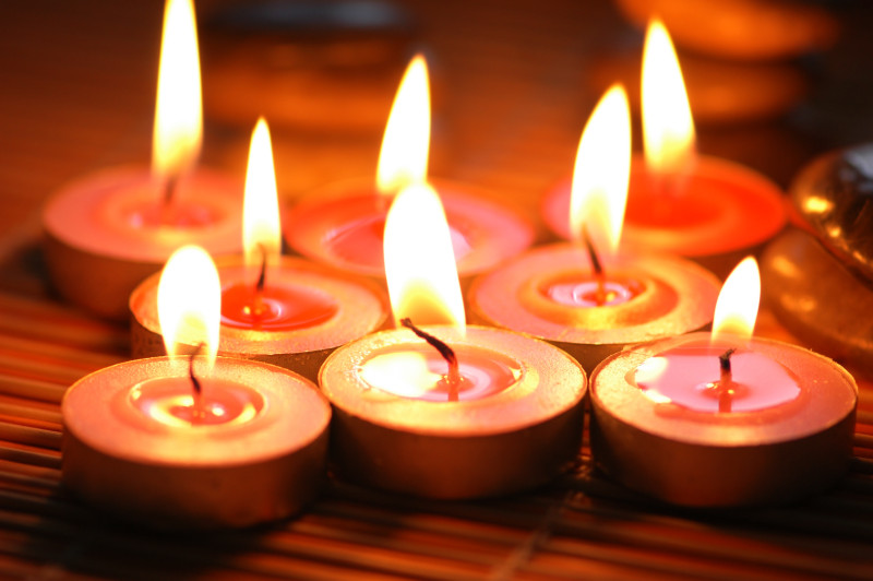 Burning scented candles for aromatherapy session